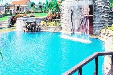 Luxury resorts near bangalore for Swimming pool near sahakar nagar bangalore